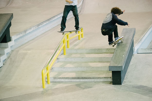 Nassim Guammaz smiths up the hubba whilst a headless man boardslides.